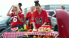 Tailgate: Women Laugh And Have Fun While Preparing Food Stock Footage