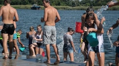 Children teenagers poured water on each other in the hot summer - wet body Stock Footage