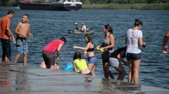 Young people poured water on each other in the hot summer - wet body - stock footage