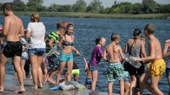Young people poured water on each other in the hot summer - wet body Stock Footage