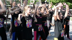 Beautiful girls are dancing in the street - stock footage