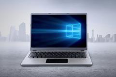 Laptop computer with windows 10 wallpaper Kuvituskuvat