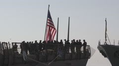 Group of US marines stands on the deck of missile destroyer Stock Footage