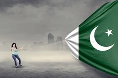 Pakistani woman pulling a flag Stock Photos