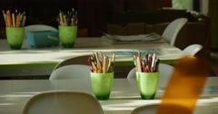 White Tables White Plastic Chairs Green Cups With Pencils On The Tables John Stock Footage