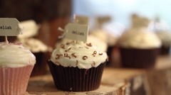 Delicious Cup Cakes on Display - Slow Pan Stock Footage