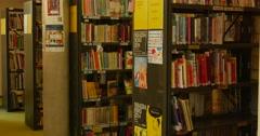 Bookshelves Rows Of Books Teenage Boy Walks Near Bookshelves Indoors John Paul Stock Footage