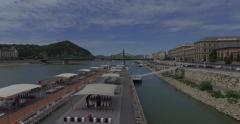 Flying near Liberty Bridge on Danube river in Budapest city. Stock Footage
