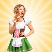 Beautiful sexy Oktoberfest woman wearing a traditional Bavarian dress Stock Photos