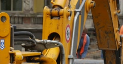 Moving Excavator Scoop Close Up Workers Men in Orange Workwear And Helmets Stock Footage