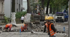 Workers in Yellow Workwear Are Carrying The Blocks at The Street Paving the - stock footage