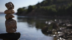 Cairn on shore of Sea Stock Footage