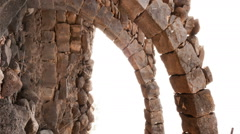 Vertical shot of Tracking time lapse under two stone arches Stock Footage