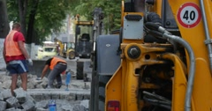 Workers in Orange Workwear Are Paving the Road at City Street Road Repair Stock Footage
