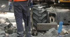 Worker Man in Orange Workwear is Standing Legs Close Up Heap of Blocks Yellow Stock Footage