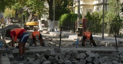Workers in Workwear Road Repair Are Moving The Blocks Paving the Road Yellow Stock Footage