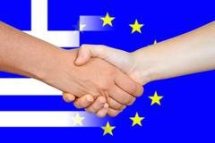 EU and Greece flags with a handshake - stock photo