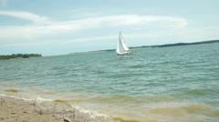 Sailboat sailing close to the shoreline Stock Footage