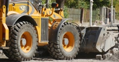 Yellow Excavator Close Up Grabs The Blocks with Scoop Transports the Blocks Stock Footage