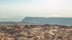 Panning shot of Daytime time-lapse at Masada, Israel. Stock Footage