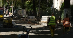 Workers in Yellow Workwear Are Leaving Walking Away Man Strikes the Stone by Stock Footage