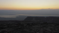 Panning shot of Sunrise time-lapse at Masada Stock Footage