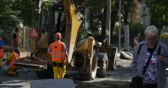 Workers in Yellow Workwear And Helmets Are Holding the Loader and Carrying it Stock Footage