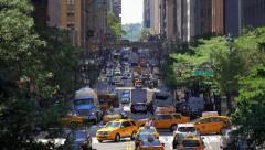 Manhattan busy congested street traffic jam rush hour cars New York City NYC day - stock footage