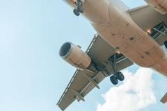 Zoomed view of airplane in the sky - stock photo