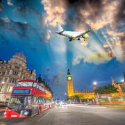Sunset in London with public transportation system - stock photo