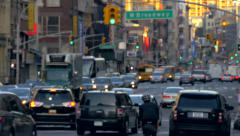 Congested busy street traffic rush hour cars jam Manhattan New York City NYC day - stock footage