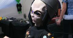 4K stuffed toy alien on motorcycle at UFO days festival roswell, New Mexico Stock Footage