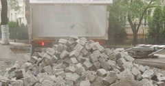 Lorry Have Unloaded the Heap of Blocks Transports The Blocks Road Repair Paving Stock Footage