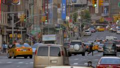 Busy street traffic cars commute Manhattan Chinatown New York City NYC day Stock Footage
