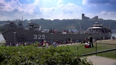 Tourists Visit LST-325 Docked on Pittsburgh North Shore Stock Footage