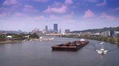 Coal Barge Travels on River Near Pittsburgh Stock Footage