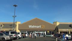 Walmart storefront customers, drive up - stock footage