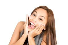 Blissful Asian Woman Portrait Reacting Good News - stock photo
