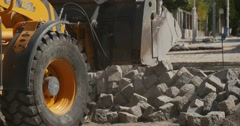 Yellow Excavator Scoop Grabs The Blocks Excavator Wheels Close Up Road Repair Stock Footage