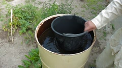 Set water bucket from the barrel Stock Footage