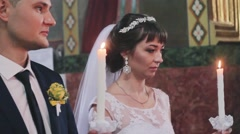 Beautiful Young Couple Getting Married in a church. Ukrainian wedding. Stock Footage