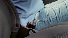 The Driver Wear a Seat Belt Sitting in The Car. A man dressed in blue shorts - stock footage