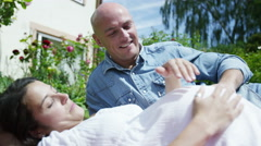 4K Happy young couple expecting a baby, relaxing outdoors Stock Footage