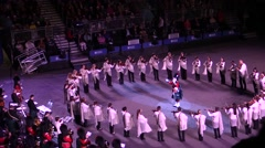 Scottish military parade .Dancers ,violinists,bagpipes. Orchestra director Stock Footage