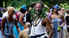 Black man with painted face dancing Stock Footage