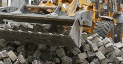 Yellow Excavator is Moving Excavator Close Up Scoop Unloads the Blocks Heap of Stock Footage