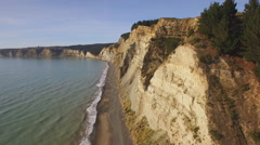 Eroding cliffs aerial view acsent Stock Footage