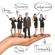 Business people in humans hand with unity idea - stock photo