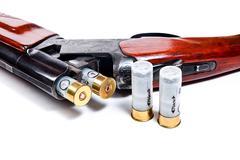 Hunting shotgun and ammunition on white background. - stock photo