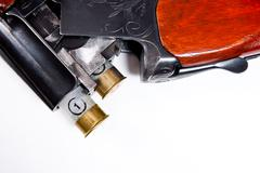 Hunting shotgun and ammunition on white background. Stock Photos